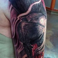 Dramatic 3D colored bloody Spartan warrior helmet tattoo on shoulder