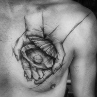 Dramatic black ink painted by Inez Janiak chest tattoo of hands holding shell with pearl