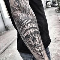 Dramatic blackwork style designed by Inez Janiak sleeve tattoo of Indian skull with big helmet