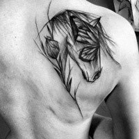 Dramatic blackwork style designed by Inez Janiak scapular tattoo of horse with flower