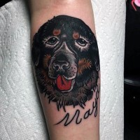 Dramatic like memorial dog portrait with lettering tattoo on arm