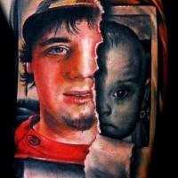 Dramatic looking colored biceps tattoo of man and baby photos