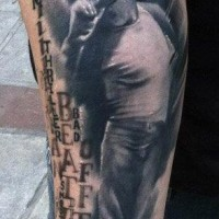 Dramatic memorial style Michael Jackson portrait with lettering tattoo on arm