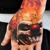 terribile pagliaccio in fuoco tatuaggio sul mano da Kyle Cotterman