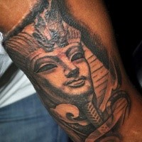 Egypt style small arm tattoo of big statue