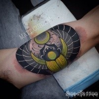 Egypt themed colored biceps tattoo of big Bug with symbols