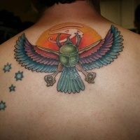 Egypt themed colorful mystical bird tattoo on upper back combined with stars