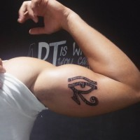 Egyptian ancient symbol dark black and white the Eye of Horus tattoo on biceps with original ornament