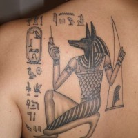 Egyptian anubis tattoo on shoulder blade