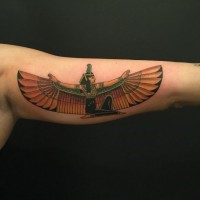 Egyptian goddess Maat colored tattoo on biceps