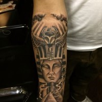 Egyptian Pharaoh Tutankhamen, pyramids and scarab forearm length tattoo