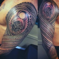 Egyptian scarab sleeve tattoo in tribal style