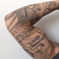 Egyptian style tattoo on whole arm