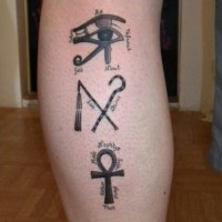 Egyptian symbols of power tattoo on leg