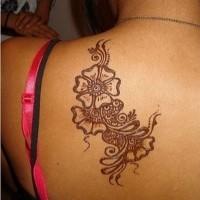 Elegant black floral patterns tattoo on back