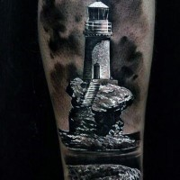 Elegant designed and painted old light house tattoo on leg