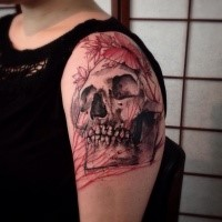 Engraving style big shoulder tattoo of human skull and butterfly