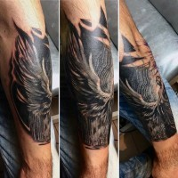 Engraving style black and white forearm tattoo of mysterious angel