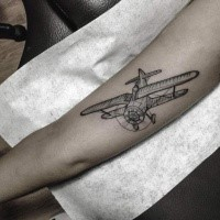Engraving style black ink arm tattoo of small plane