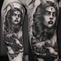 Engraving style black ink arm tattoo of mystical devil woman with skull and knife