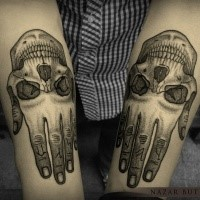 Engraving style black ink arms tattoo of humans hand with skull