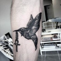 Engraving style black ink bird with cross tattoo