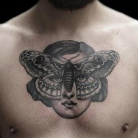 Engraving style black ink chest tattoo of woman face with butterfly shaped mask