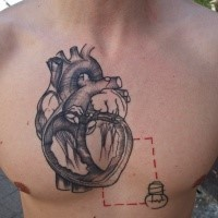 Engraving style black ink chest tattoo of human heart with small bulb and square
