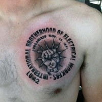Engraving style black ink chest tattoo of lineman workers symbol with lettering