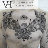Engraving style black ink chest tattoo of horse heads with flowers and mystic eye