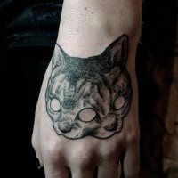 Engraving style black ink hand tattoo of creepy cat mask