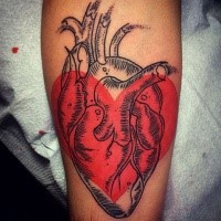 Engraving style black ink heart tattoo combined with red heart