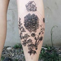 Engraving style black ink leg tattoo of bee with plants