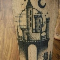 Engraving style black ink leg tattoo of fantasy castle with moon
