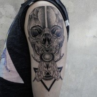Engraving style black ink shoulder tattoo of human skull with butterfly