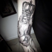 Engraving style black ink sleeve tattoo of king with big beautiful crown