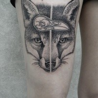 Engraving style black ink thigh tattoo of fox head with bird skull