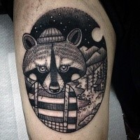 Engraving style black ink thigh tattoo of funny raccoon in night forest
