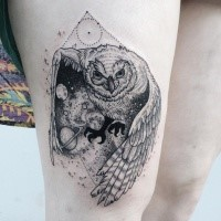 Engraving style black ink thigh tattoo of owl with solar system