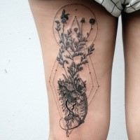 Engraving style black ink thigh tattoo of lizard skeleton with plants
