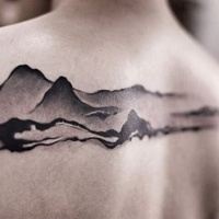 Engraving style black ink upper back tattoo of mountains