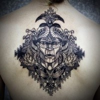 Engraving style black ink upper back tattoo of mystical face with birds and mushrooms