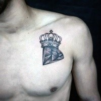 Engraving style colored chest tattoo of diamond and crown