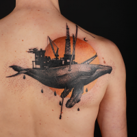 Engraving style colored scapular tattoo of big whale with oil tower