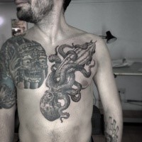 Engraving style large chest tattoo of incredible octopus