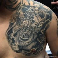 Engraving style very detailed chest tattoo of big crown with rose
