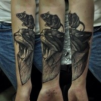 Engraving style very detailed forearm tattoo of creepy cat with mouse