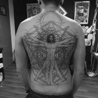 Enormous black ink whole back tattoo of Vitruvian man with sun