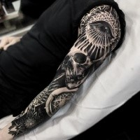 Enormous blackwork style sleeve tattoo of human skull with mysterious eye and floral ornament