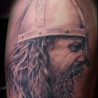 Evil viking tattoo on shoulder